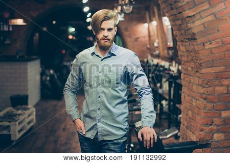 Red Bearded Harsh Man With A Trendy Hairstyle, Wearing Jeans Casual Outfit. He Is A Customer In A Re