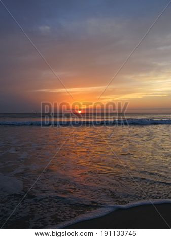 Tropical sunset at low tide. Evening near the sea