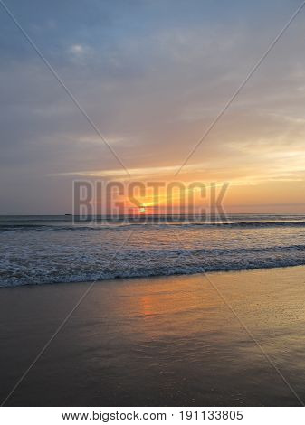 Soft Sea Ocean Waves Wash Over Golden Sand Background. Sunset Sunrise Sun. Toned like instant photo