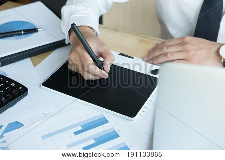 Young Graphic Designer Working With Computer. Creative Man Using Digital Tablet And Stylus Pen At Mo