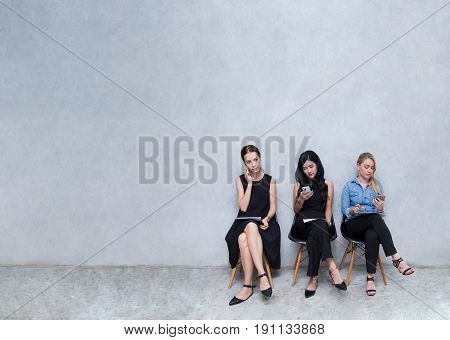 Business groups to using phones. During the wait for the interview at modern office with copy space