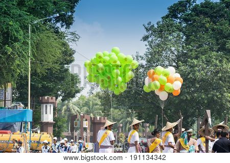 KOLKATA WEST BENGAL / INDIA - AUGUST 15TH 2016 : Colourful baloons are being carried in march past under blue sky to celebrate India's Independence day. The day is celebrate all over India with huge enthusiasm and joy.