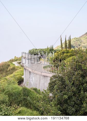 Concrete balcony with the metal fence of the viewpoint on the high mountain in the national park.