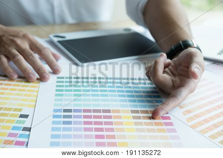 Young Graphic Designer Working With Computer, Color Swatch. Creative Man Using Digital Tablet At Mod