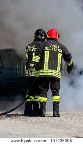 Italian Fire Brigade With The Letter On The Uniform Meaning Fire