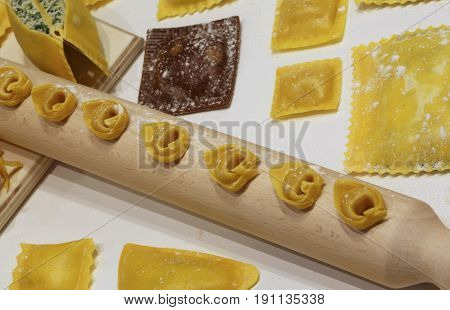 Fresh Pasta Of Many Sizes With Wooden Rolling Pin And Tortellini