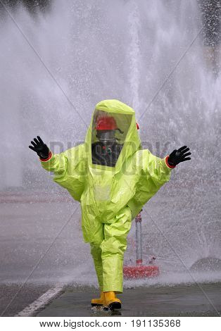 Man With A Yellow Protective Suit Against Radiation And Chemical