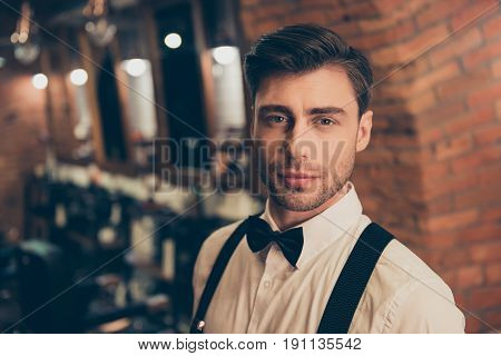 Close Up Cropped Portrait Of Handsome Young Brunette Guy With Bristle In A Barber Shop, Dressed Clas