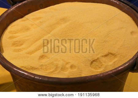 Yellow Flour In Old Copper Cauldron