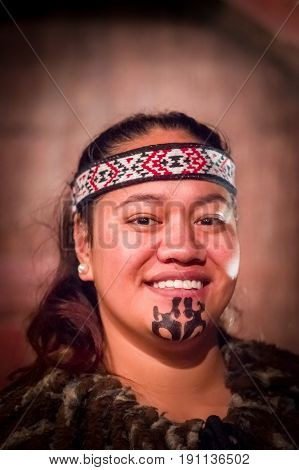 NORTH ISLAND, NEW ZEALAND- MAY 17, 2017: Portrait of Tamaki Maori man with traditionally tatooed face in traditional dress at Maori Culture, Tamaki Cultural Village, Rotorua, New Zealand.