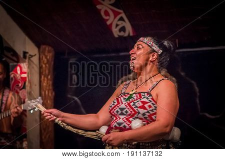 NORTH ISLAND, NEW ZEALAND- MAY 17, 2017: Close up of a Tamaki Maori woman with traditionally tatooed face and wearing traditional dress at Maori Culture village in Tamaki Cultural Village, Rotorua, New Zealand.