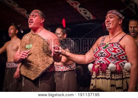NORTH ISLAND, NEW ZEALAND- MAY 17, 2017: Tamaki Maori couple with traditionally tatooed face in traditional dress at Maori Culture, Tamaki Cultural Village, in New Zealand.