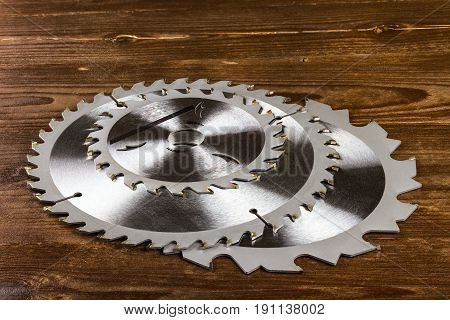 circular saw blades on the wooden background