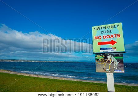 NORTH ISLAND, NEW ZEALAND- MAY 18, 2017: An informative sign of swim only zone not boat located at Taupo, New Zealand.