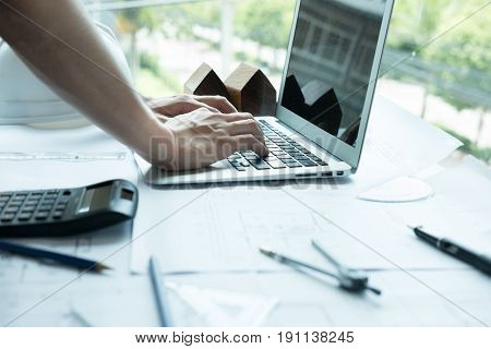 Architect Working On Real Estate Project At Workplace. Male Engineer Hand Working With Laptop Comput