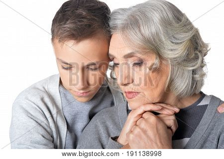 Family portrait of sad grandmother and grandson isolated on white background