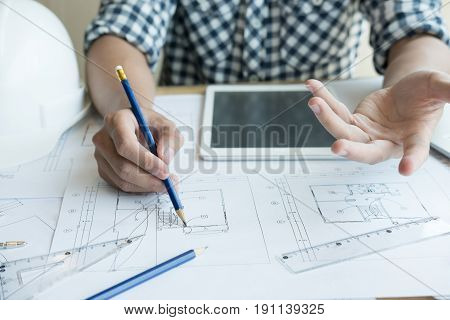 Architect Working On Real Estate Project At Workplace. Male Engineer Hand Working With Living House