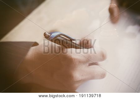 Man Writing On Paper Document In Office. Businessman Or Job Seeker Signing On Contract Or Applicatio
