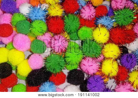 Small multi colored pompons as a background