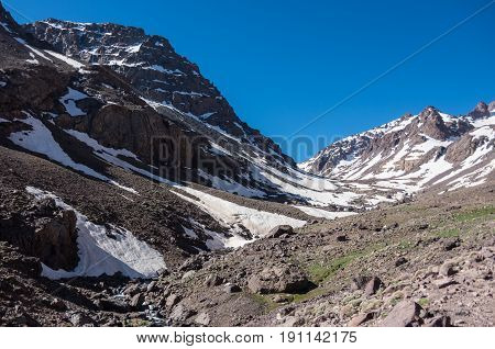 Toubkal National Park In Springtime With Mount, Cover By Snow And Ice, Valley Near Refuge Toubkal, S