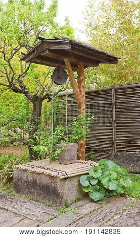HIMEJI JAPAN - MAY 16 2017: Traditional well in Kokoen Garden near Himeji castle Japan. Garden was laid out in 1992 to commemorate 100 anniversary of Himeji city