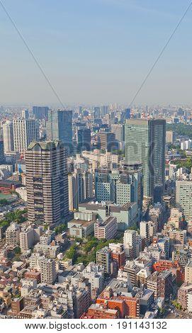 TOKYO JAPAN - MAY 21 2017: Skyscrapers of Akasaka district in Tokyo Japan. Akasaka Park Building (circa 1993) TBS broadcasting center (circa 1994) Akasaka Biz Tower (circa 2005) and others