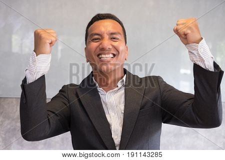 Successful Businessman Gesturing With Happiness And Gladness At Office. Start Up Entrepreneur Enjoys