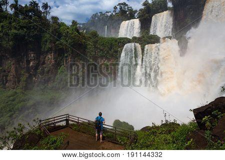 man looking at the wellknown Iguacu waterfalls