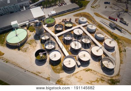 Aerial view of a sewage treatment plant. Waste water management for industrial zone. Environment and industry from above.