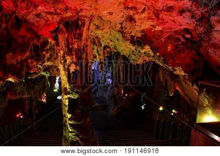 St. Michael's Cave in Gibraltar with red lights