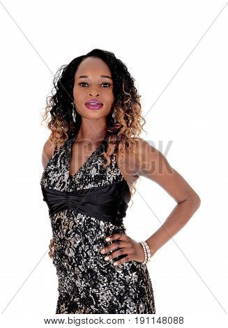 A gorgeous young African American woman with a slim figure standing in profile with hands on hip isolated for white background.
