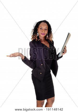 A beautiful young African American woman standing shoeing the way and holding her reports isolated for white background.