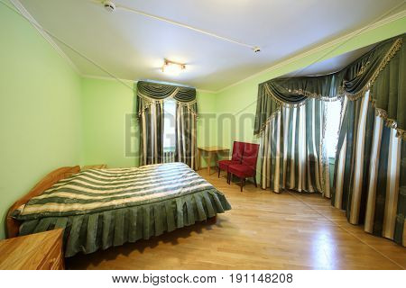 Interior of the green bedroom in the hotel