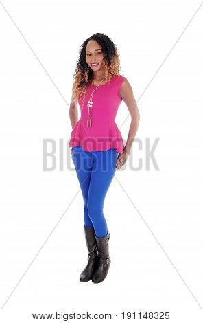 A lovely young African American woman standing in blue tights and a pink blouse isolated for white background.