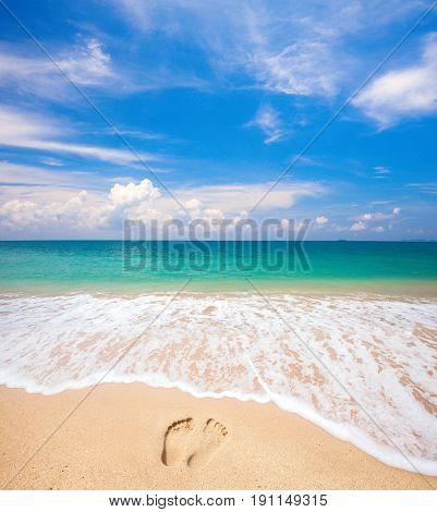 footprints on beach and tropical sea