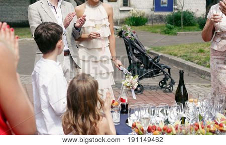 People Toasting At Wedding Ceremony Reception. Wedding Couple And Guests Holding Champagne Glasses.