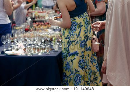 People Toasting At Wedding Ceremony Reception. Guests Holding Champagne Glasses. Open Bar In Park, F