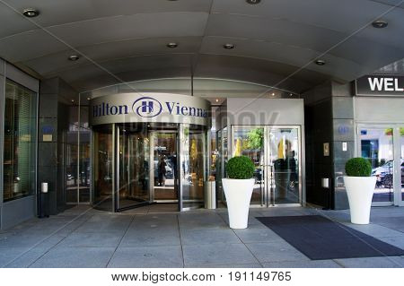 VIENNA, AUSTRIA - APR 30th, 2017: The logo above the main entrance of the Hilton Vienna Hotel in Wien, five star Hotel Hilton near the green City Park Stadtpark.