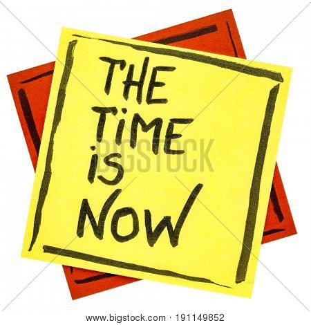 The time is now reminder - handwriting on an isolated sticky note