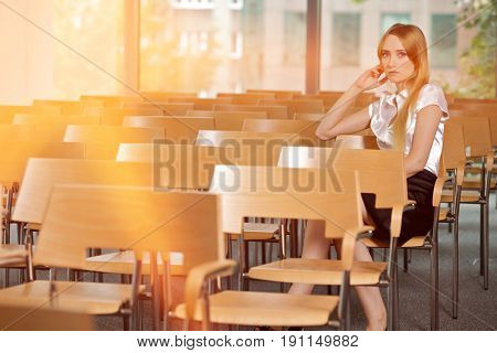Businesswoman contemplating at conference room in office