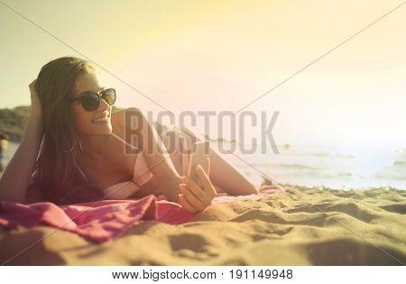 Happy girl lying at the beach