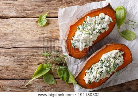 Baked Sweet Potato Stuffed With Spinach And Cream Cheese Close-up On The Table. Horizontal Top View
