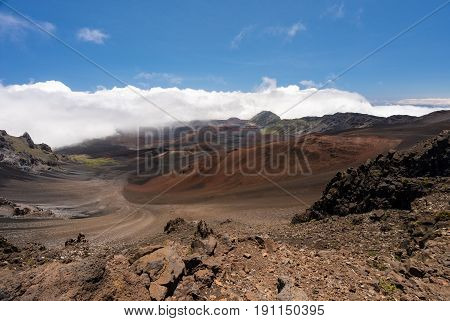Different colors of rocks and lava in crater at top of Haleakala mountain on Hawaiian island of Maui