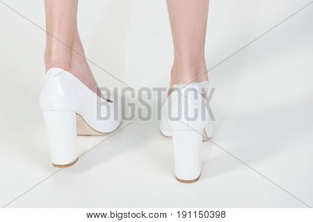 Adhesive Plaster On Leg With Wound In Fashionable Shoes, Girl