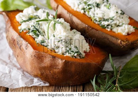 Nourishing Food: Stuffed Sweet Potato With Cheese And Spinach Close-up. Horizontal