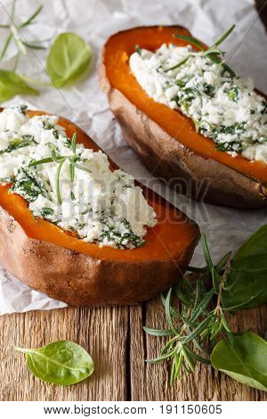 Tasty Baked Sweet Potato Stuffed With Spinach And Feta Close-up. Vertical