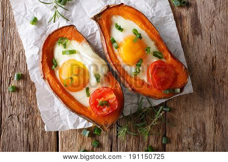 Healthy Food: Baked Sweet Potato With Fried Egg And Tomato Close-up On The Table. Horizontal Top Vie