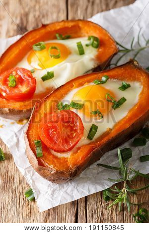Hearty Breakfast: Sweet Potato Stuffed With Egg And Tomato Close-up. Vertical