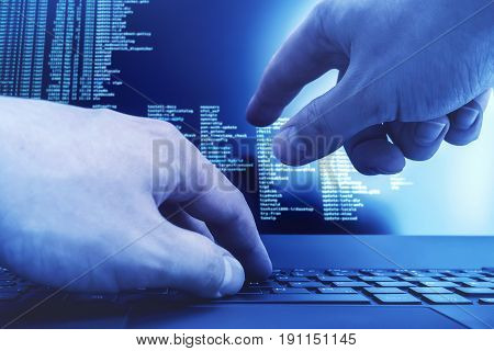 Hacker hands working on a console commands. Internet cyber concept. Blue cold toning.