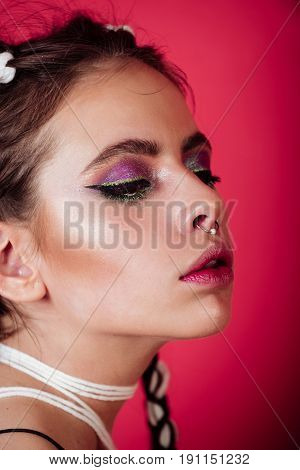 Pretty Girl With Cute Face And Color Makeup